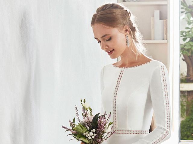 El escote barco en vestidos de novia: la fórmula que combina sencillez y elegancia