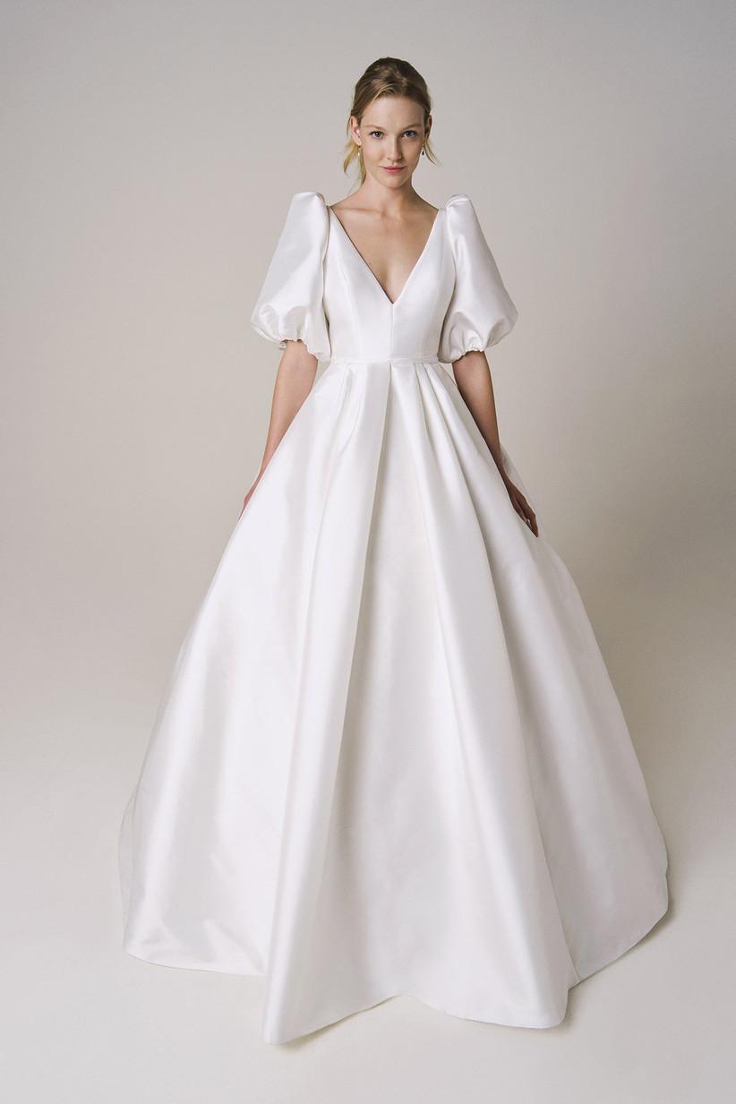 vestido de novia blanco corte princesa y mangas con volumen
