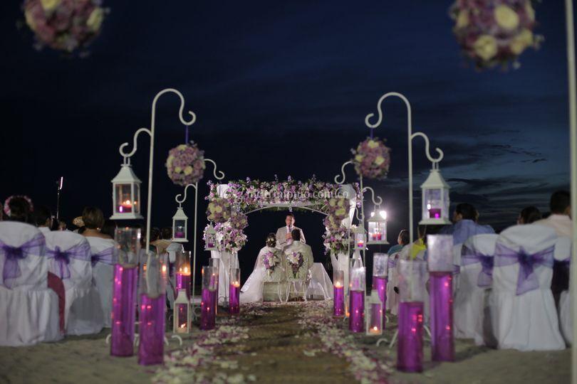 Película de boda playa noche